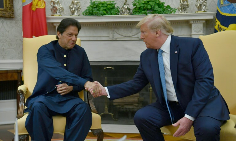US President Donald Trump praised Pakistan for its help in advancing peace talks in Afghanistan as he hosted Prime Minister Imran Khan in the Oval Office on July 22. — AFP