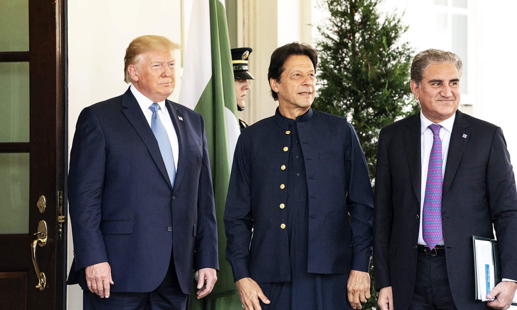 Foreign Minister Shah Mahmood Qureshi pictured with PM Imran and President Trump.  — Photo courtesy White House Flickr