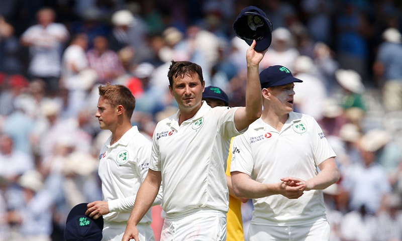 Ireland's Tim Murtagh walks off the field after taking 5 wickets and leaving England to bowl on the first day of the first cricket Test match between England and Ireland at Lord's. — AFP