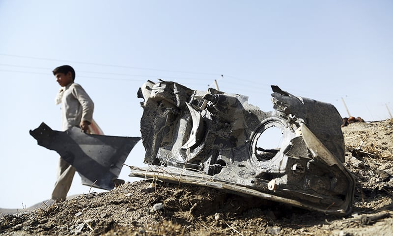 An Afghan boy collects the remains of a suicide attacker's vehicle in Kabul, Afghanistan, Wednesday, July 24, 2019. — AP