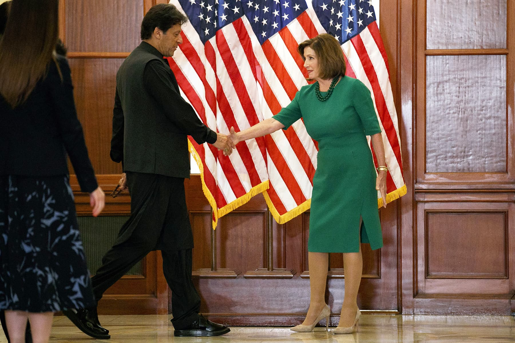 House Speaker Nancy Pelosi of California shakes hands with PM Imran on July 23 at Capitol Hill in Washington. — AFP