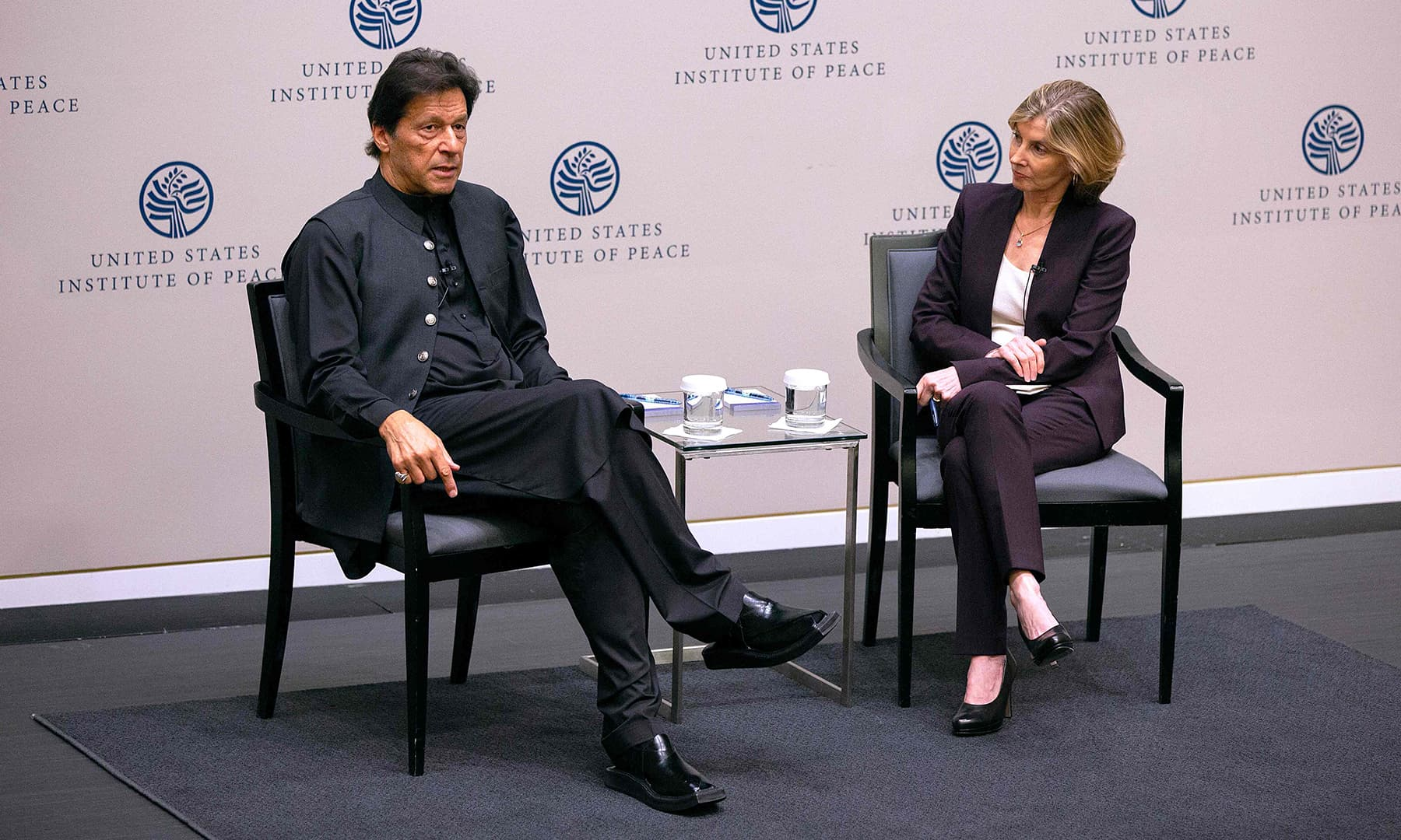 PM Khan and United States Institute of Peace President Nancy Lindborg take part in a discussion. — AFP