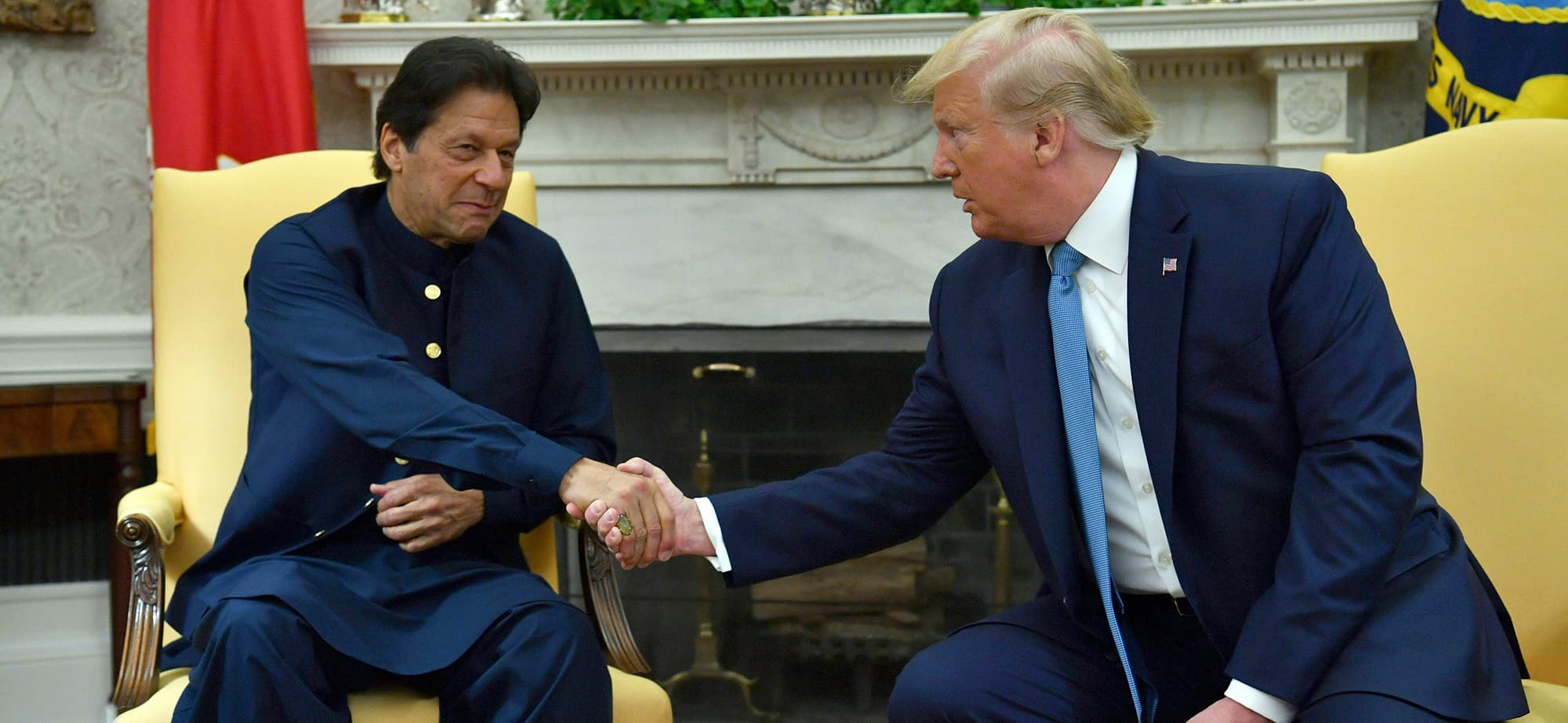 US President Donald Trump meets with Pakistani Prime Minister Imran Khan (L) in the Oval Office at the White House in Washington, DC, on July 22, 2019. (Photo by Nicholas Kamm / AFP) — AFP or licensors