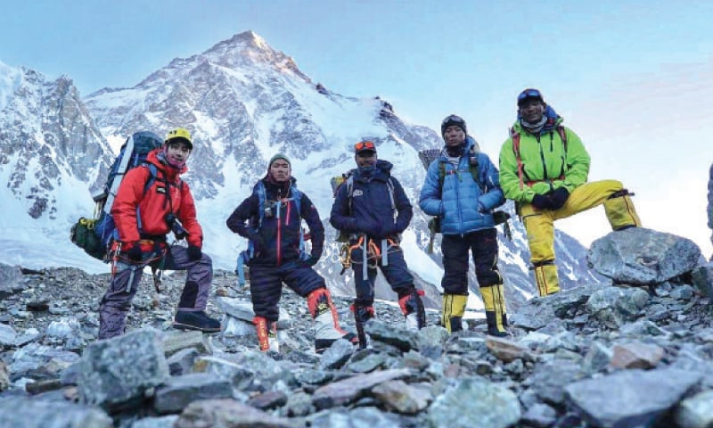 A group of Nepalese climbers at base camp of K2. — Dawn