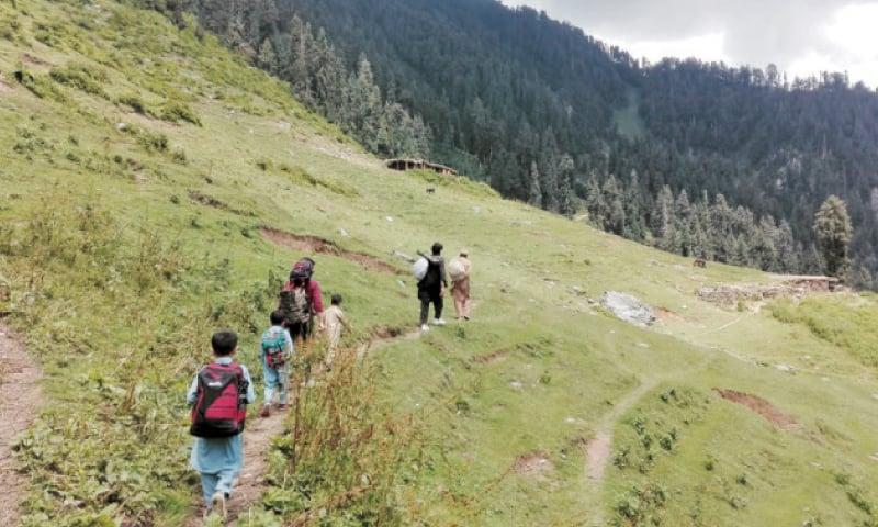 A family treks through Speen Ghar valley of Shangla. — Dawn