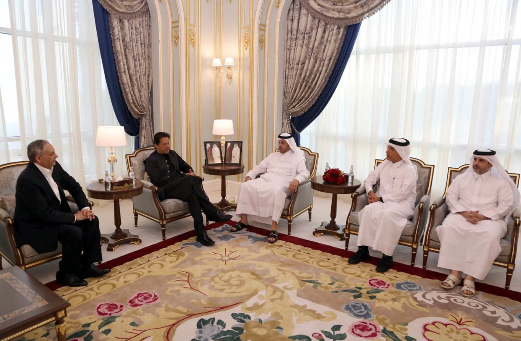 Qatari PM Abdullah bin Nasser bin Khalifa Al Thani meeting PM Imran during his brief layover at Doha International Airport on July 24. — PID