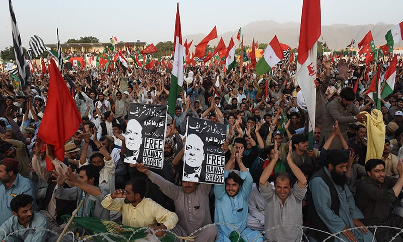 Supporters of opposition parties chant slogans during an anti-govt protest rally in Quetta on July 25. — AFP