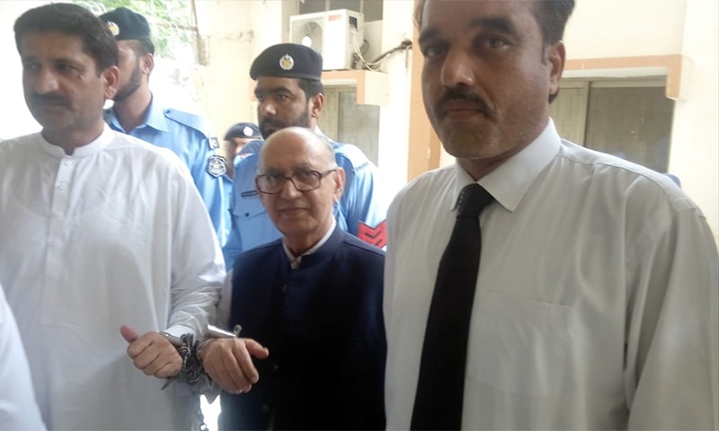 Irfan Siddiqui (C) is presented before a magistrate in handcuffs on Saturday. — Photo by author