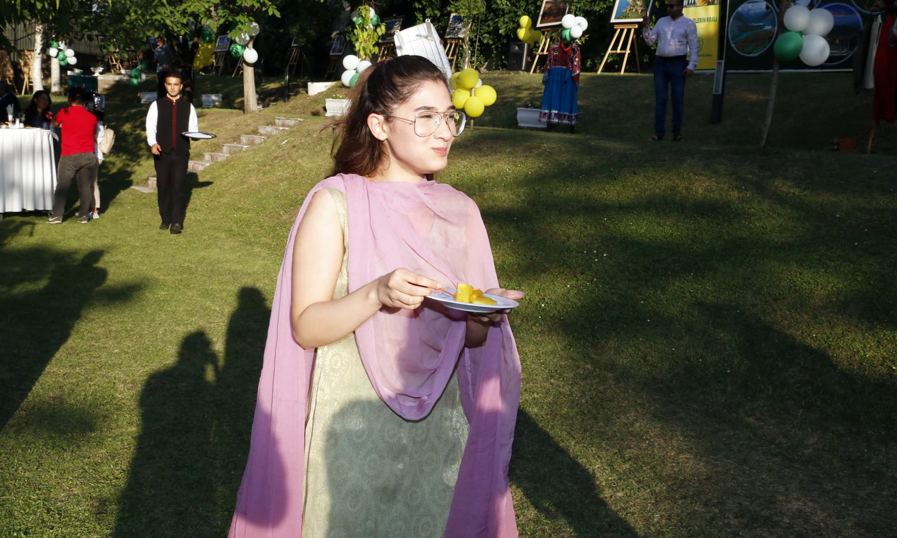 A girl pictured enjoying a taste of the mangoes.