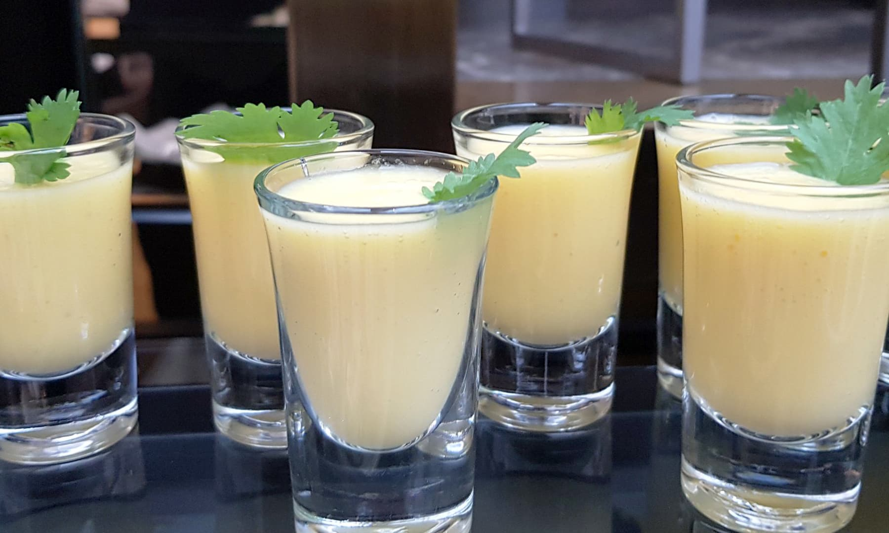 Mango flavoured drinks are arranged in a visually appealing display.