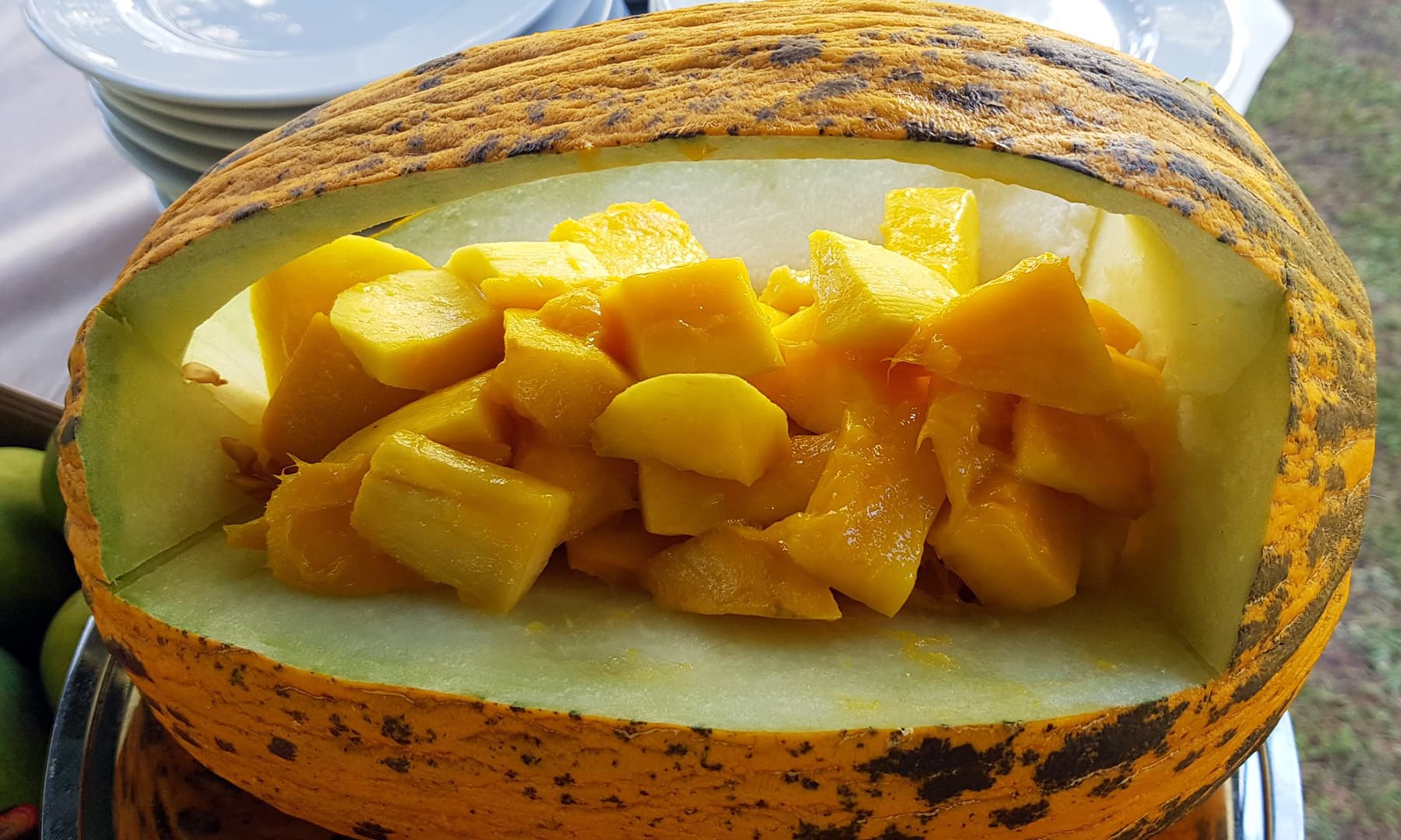 Sweet, ripe mango cut up and displayed artistically to enhance its appeal.
