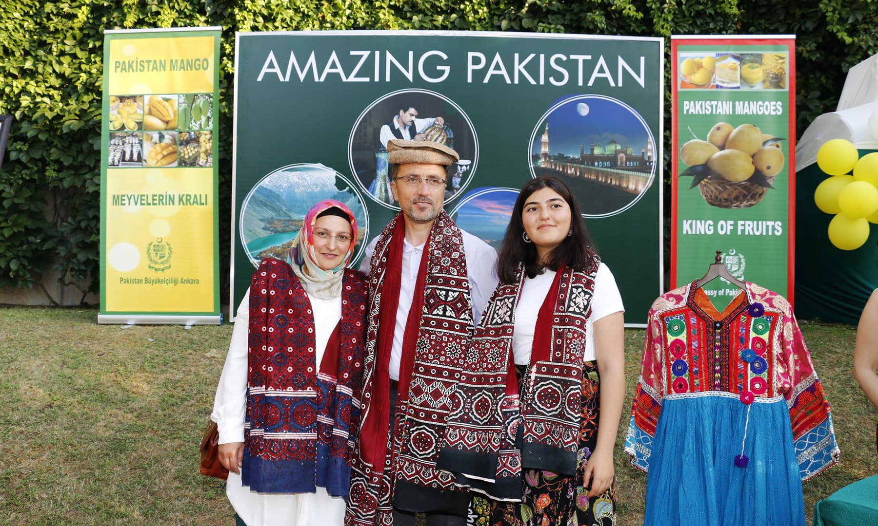 A family poses for a photograph while wearing traditional Sindhi ajrak.