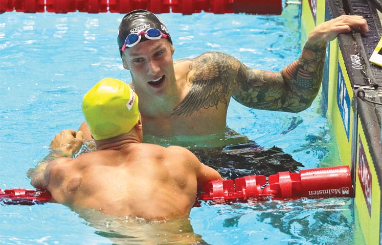 GWANGJU: Caeleb Dressel (R) of the US is congratulated by Brazil's Bruno Fratus after winning the men's 50m freestyle final at the World Swimming Championships on Saturday. — AP
