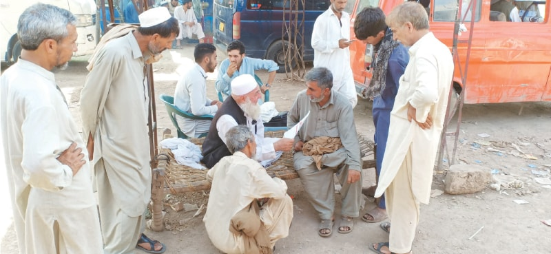 Wagon drivers and conductors discuss their problems with Noor Mohammad
