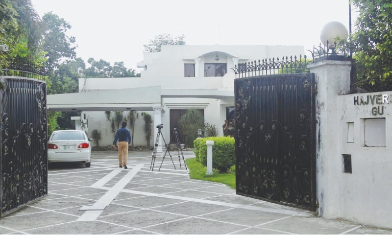 LAHORE: A man is pictured inside Hajvery House, the residence of former finance minister Ishaq Dar in Gulberg-III, before it was seized on the directives of the National Accountability Bureau. — Online