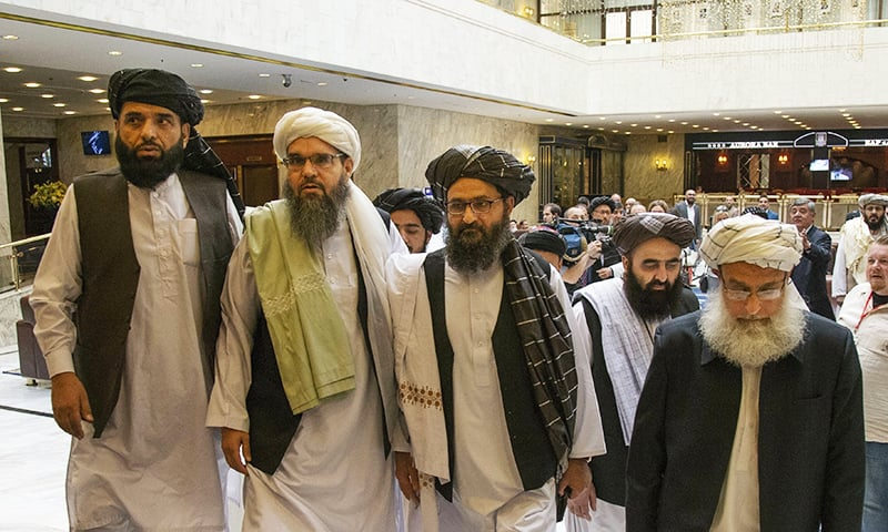 Mullah Abdul Ghani Baradar, the Taliban's top political leader, third from left, arrives with other members of the Taliban delegation for talks in Moscow, Russia. ─ AP