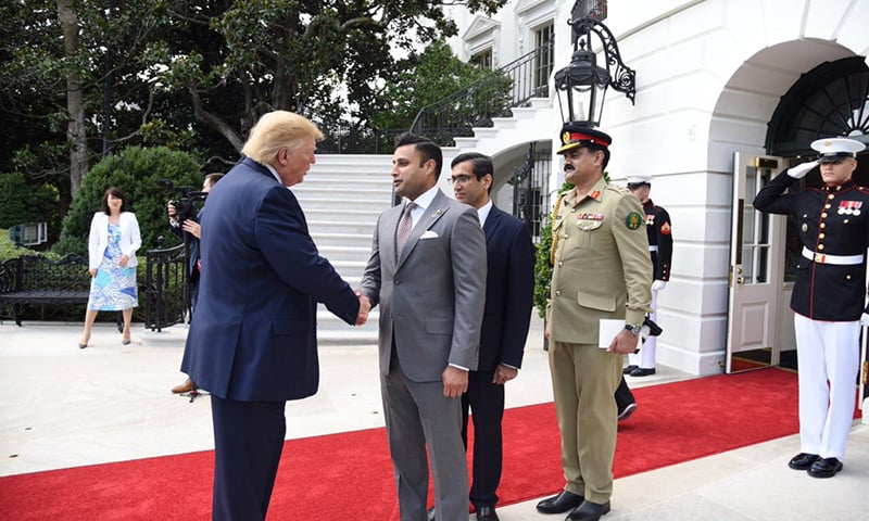 Minister of State for Overseas Pakistanis Syed Zulfiqar Abbas Bukhari shaking US President Donald Trump's hand. — Photo courtesy Sayed Z Bukhari Twitter account