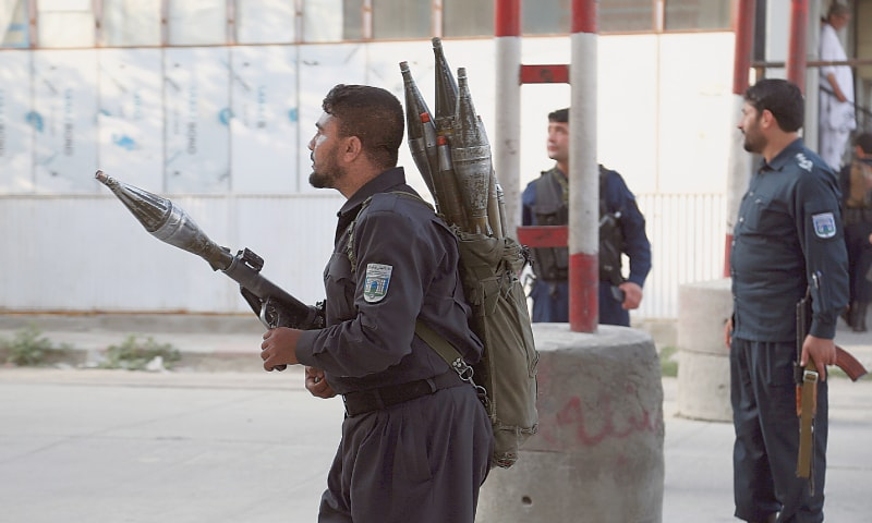 KABUL: Two security personnel take position near the site of the attack. — AP
