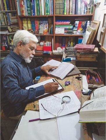 CALLIGRAPHER Ghulam Mohiuddin working in his studio.