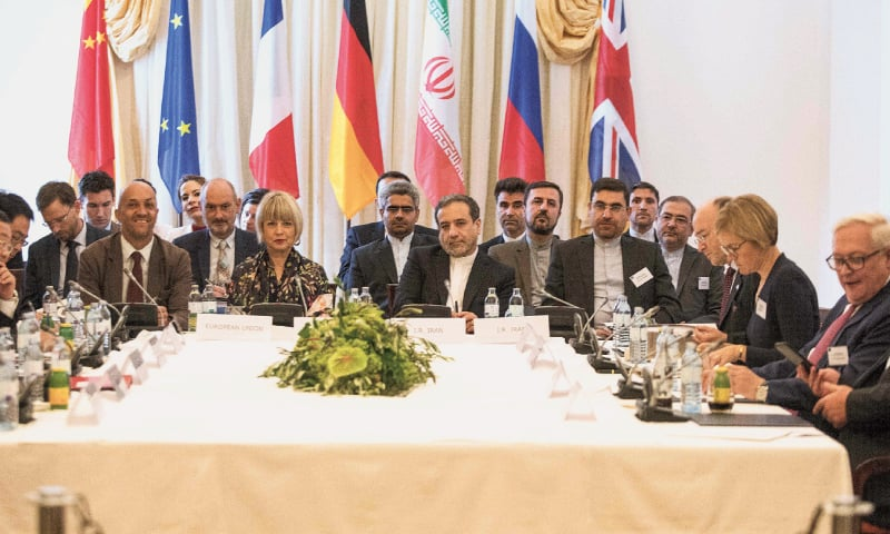 Vienna: Abbas Araghchi (centre right), an official of Iran's foreign ministry, and Helga Schmid (centre left), Secretary General of the European Union's external action service, take part in a meeting on Sunday of the joint commission that monitors the implementation of the 2015 Iran nuclear deal. — AFP