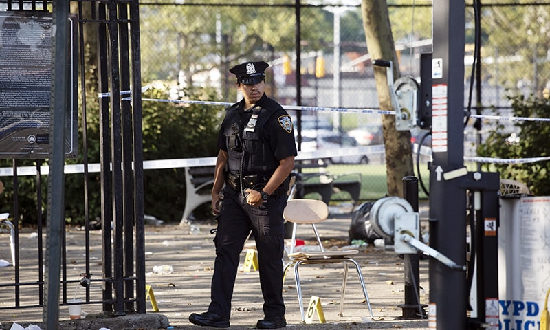 Gunfire at NY festival leaves one dead, 11 injured