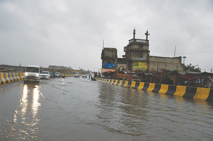 Standing water can be seen on the Lyari Expressway.—Faisal Mujeeb / White Star