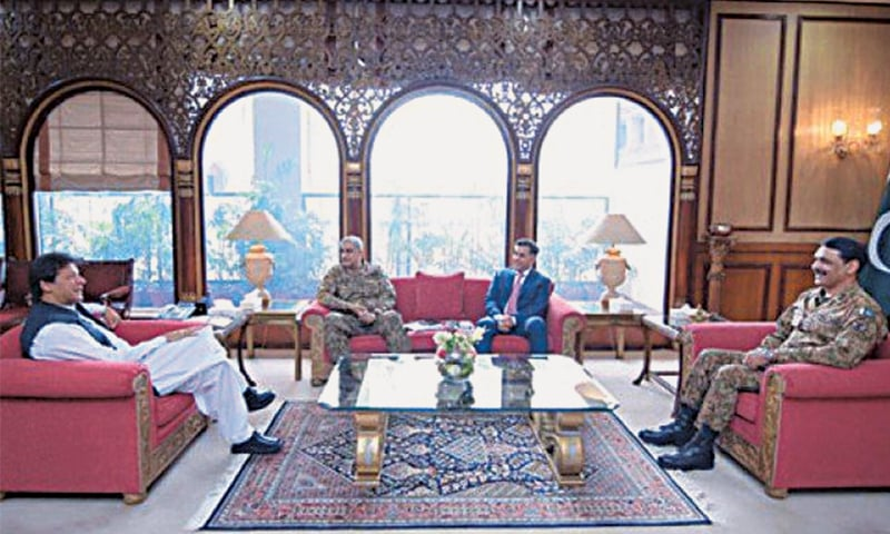 ISLAMABAD: Prime Minister Imran Khan holds a meeting with Chief of the Army Staff General Qamar Javed Bajwa, Director General of Inter-Services Intelligence Lt Gen Faiz Hameed and Director General of Inter-Services Public Relations Maj Gen Asif Ghafoor at the PM Office on Monday. — APP