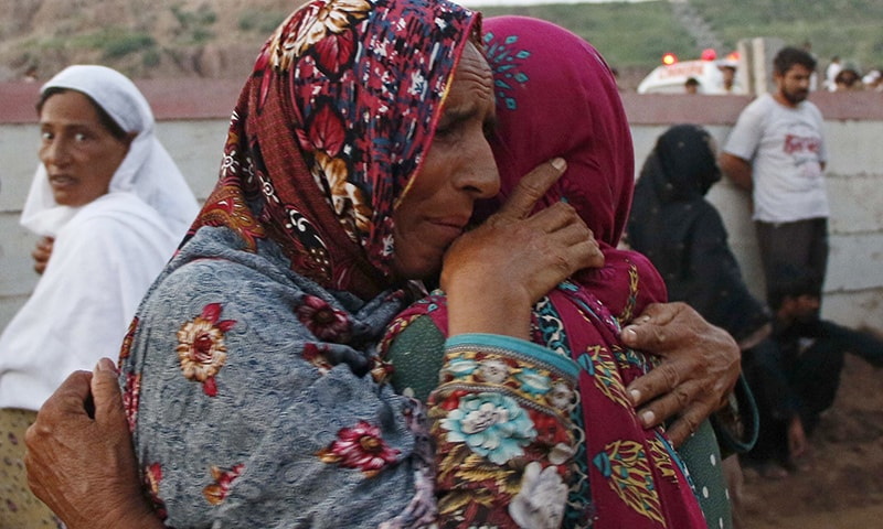 Women mourn the death of their relatives after a Pakistan Army aviation aircraft on a routine training flight crashed near Mora Kalu Rawalpindi. — Reuters