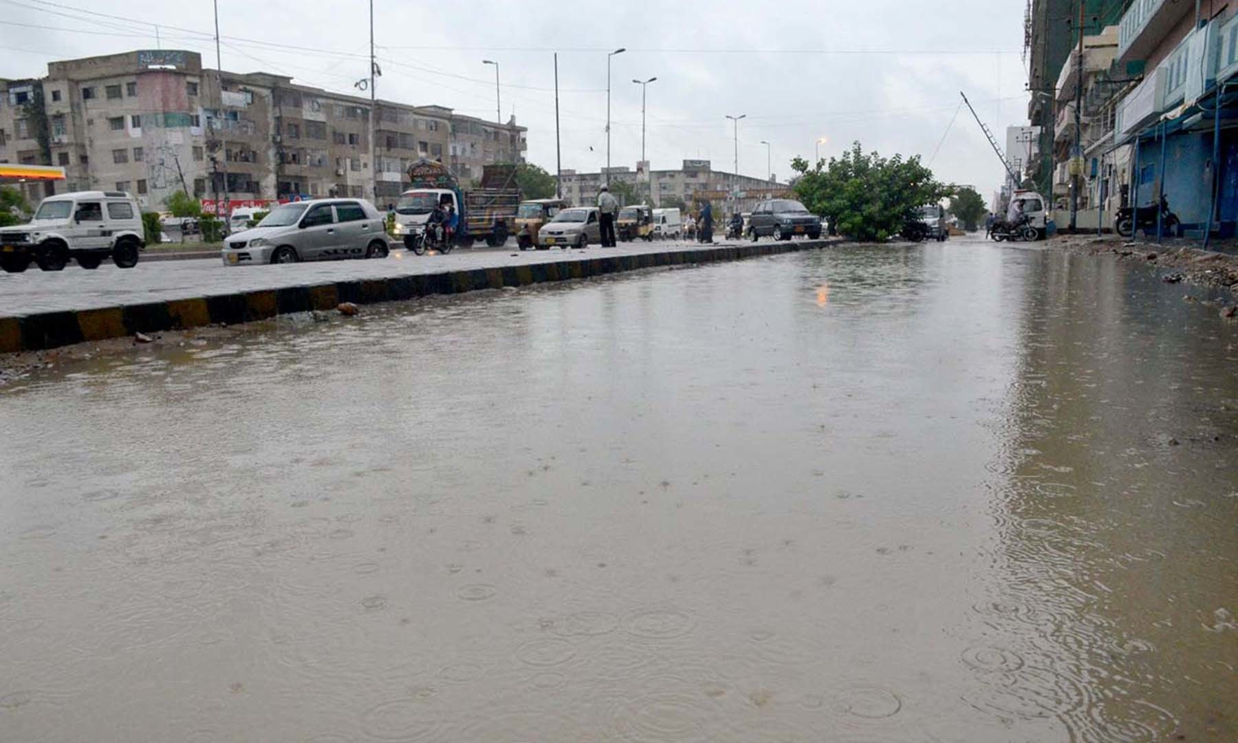 A view of stagnant water during heavy rain in Karachi on Monday. — APP