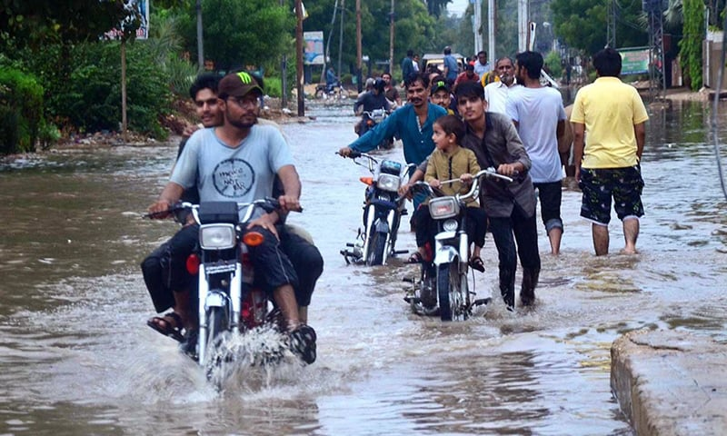 In pictures: Monsoon rain brings relief from heat in Sindh but disrupts lives of citizens