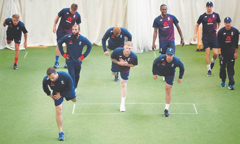 BIRMINGHAM: England cricketers undergo physical exercises during an indoor training session at Edgbaston on Tuesday.—Reuters