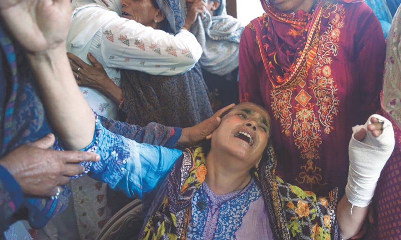 RAWALPINDI: Family members comfort Sabar Jaan as she mourns for her son, daughter-in-law and their children who were killed after the military aircraft crashed on Tuesday.—Reuters