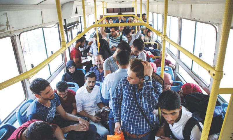 Deported from Turkey, Syrians return to unfamiliar country