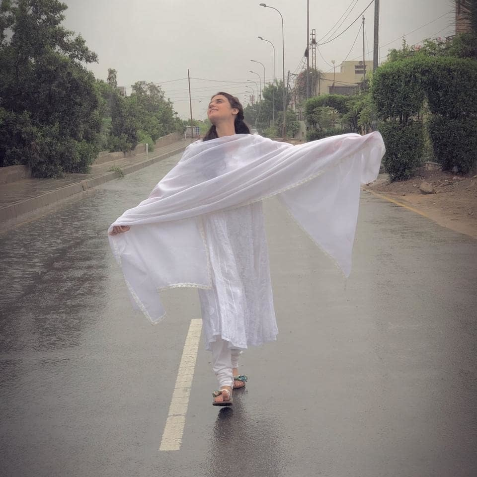 This photo reminds us of Khirad enjoying the rain scene in Humsafar. YIKES!