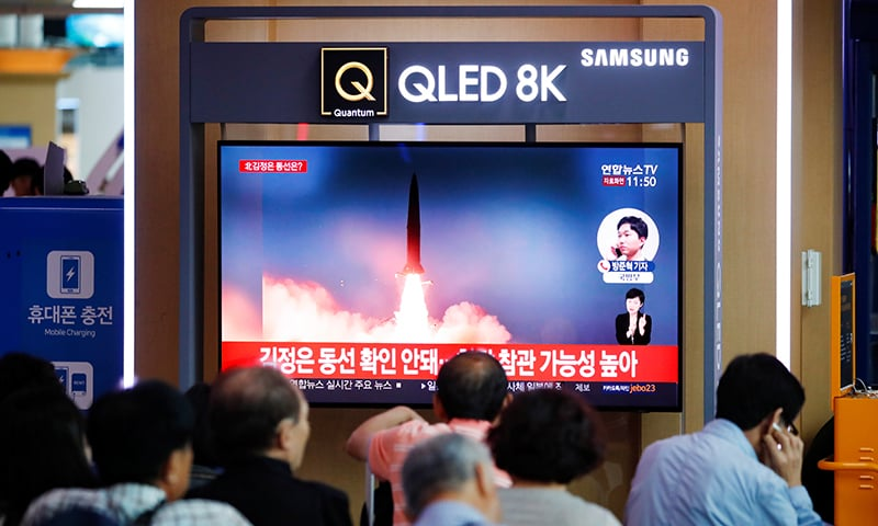 People watch a TV that shows a file picture of a North Korean missile for a news report on North Korea firing short-range ballistic missiles, in Seoul, South Korea on July 31. — Reuters