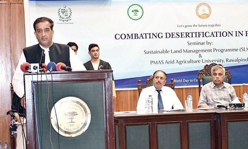 Adviser to the Prime Minister on Climate Change Malik Amin Aslam speaks at the seminar at the PMAS Arid Agriculture University on Wednesday. — APP
