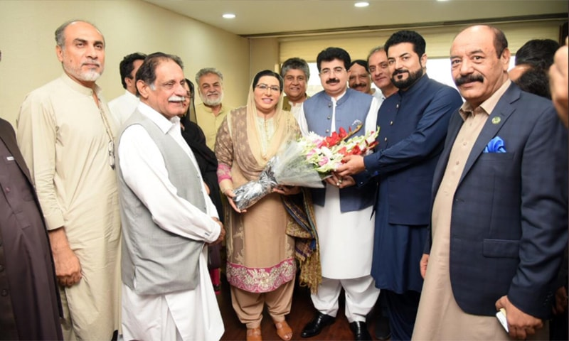 Senate Chairman Sadiq Sanjrani receives flowers from Firdous Ashiq Awan, the government's chief spokesperson, after he survived the no-confidence motion. — Photo courtesy Govt of Pakistan