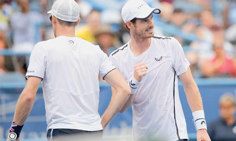 BRITAIN'S Andy Murray (R) reacts next to brother Jamie Murray during their doubles match at the Washingtion Open.—AP