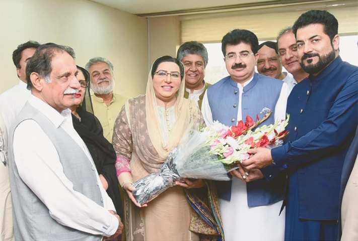 Special Assistant to the Prime Minister on Information and Broadcasting Dr Firdous Ashiq Awan presents a bouquet to Senate Chairman Sadiq Sanjrani on Thursday.—INP