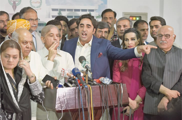 PPP chairman Bilawal Bhutto-Zardari speaks at a press conference outside the Parliament House after the defeat of opposition's no-confidence resolution against Senate Chairman Sadiq Sanjrani on Thursday. Opposition leaders Shahbaz Sharif, Hasil Bizenjo, Mian Iftikhar Hussain, Sherry Rehman, Ahsan Iqbal and Marriyum Aurangzeb, dejection writ large on their faces, are also seen.—Tanveer Shahzad / White Star