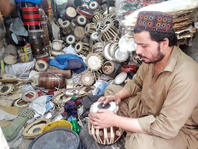 AN artisan gives final touches to tabla at his workplace in Peshawar. —Dawn
