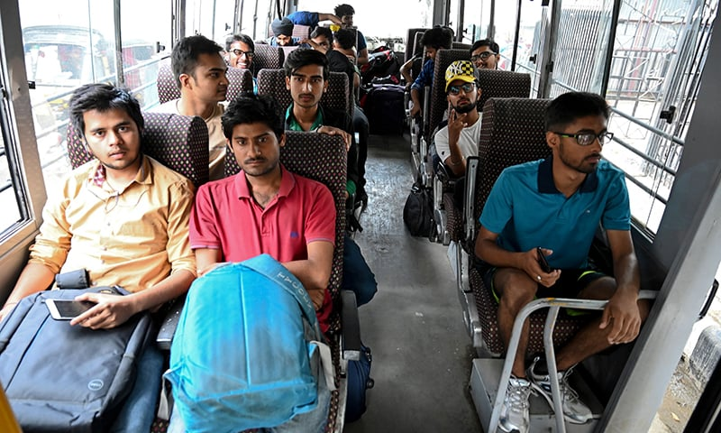 Tourists sit inside a bus as they leave Indian-occupied Kashmir in Srinagar on Saturday. — AFP