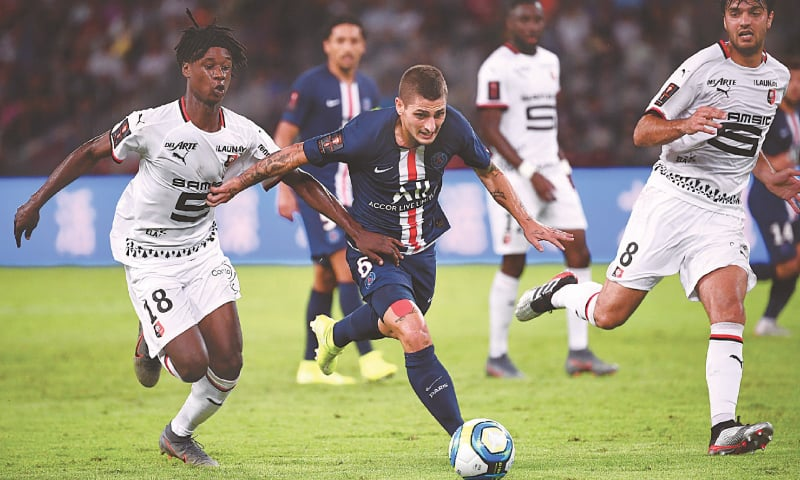 SHENZHEN: PSG's Marco Verratti (C) fights for the ball with Rennes' Eduardo Camavinga during the French Super Cup match at the Shenzhen Universiade Stadium on Saturday. — AFP