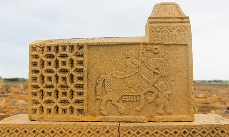 A battle scene carved on a grave