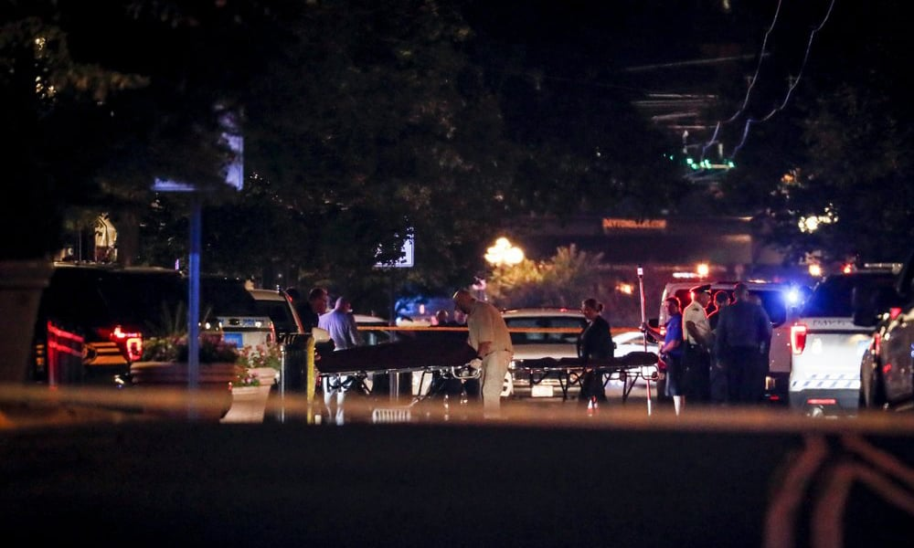 Bodies are removed from at the scene of a mass shooting on Sunday in Dayton, Ohio. — AP