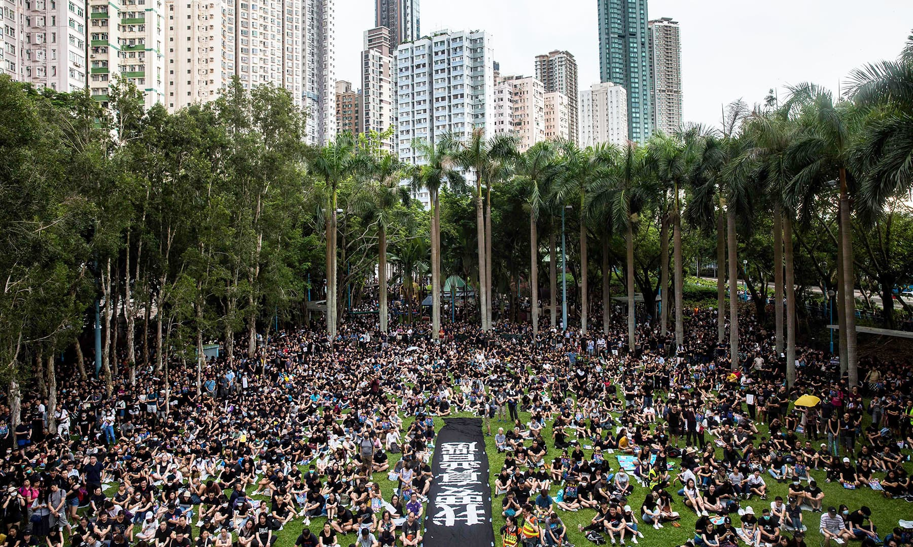 People attend a protest in the Western district of Hong Kong on Sunday. — AFP