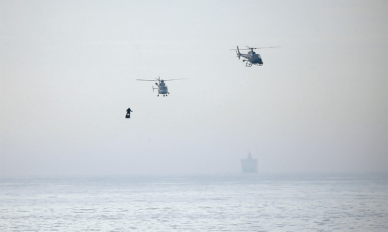 DOVER (Britain): French inventor Franky Zapata arrives here on a flyboard as he crosses the English Channel from Sangatte, France, on Sunday. Escorted by helicopters, he soared across the water in early morning light and landed 22 minutes later in this picturesque bay, to the applause of dozens of people. 'I'm feeling good. This is just an amazing moment for me,' Zapata said after landing.—Reuters