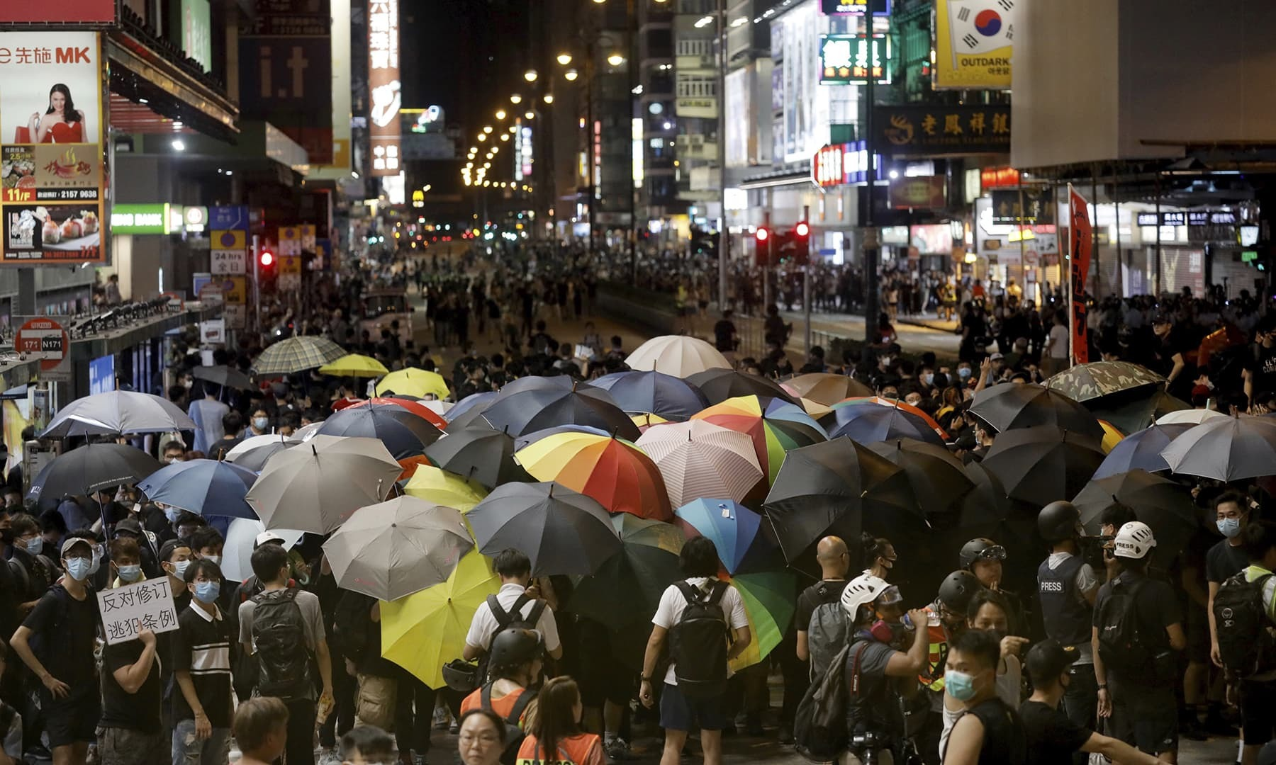 Hong Kong strike sinks city into chaos as leader vows to stay