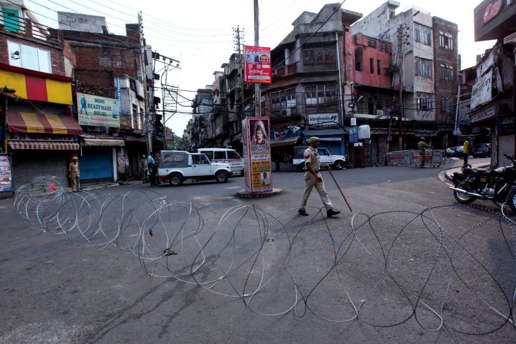 Security personnel stand guard on a street in Jammu on August 6, 2019 — AFP