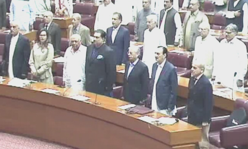 Opposition lawmakers are seen standing in the parliament during the joint session. — DawnNewsTV screengrab